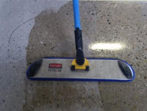 Silane Concrete Sealer Application with floor applicator image